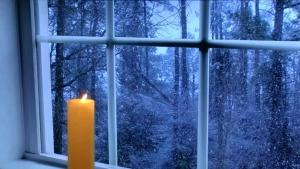 candle-in-the-window-candle-in-the-window-meaning-candle-in-the-window-golden-glowing-candle-flickers-in-front-of-candle-in-the-window-candle-window-lights